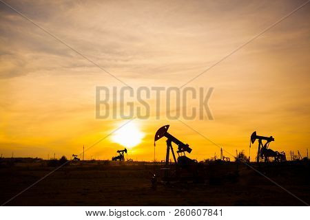 In The Evening, The Outline Of The Oil Pump. The Oil Pump, Industrial Equipment. Oil Field Site, Oil