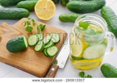 Summer Cocktail Cucumber Lemonade. Refreshing Water With Cucumber, Mint And Lemon On Grey Background