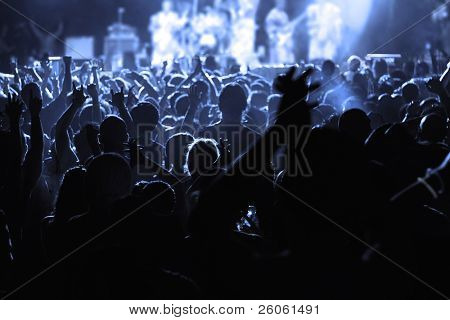 An Audience cheering for their favorite musician