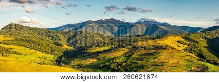 Panorama Of Mountainous Rural Area In Autumn. Wonderful Countryside With Agricultural Fields On Hill