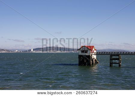 The Old Rnli Lifeboat Station, With Swansea City In The Background, Mumbles, Swansea, South Wales, U