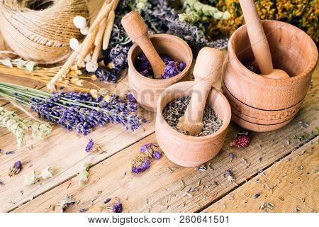 Herbal Tea, Preparation Of Medicinal Herbs, Mortar, Non-traditional Medicine, Ayurveda, Wooden Backg