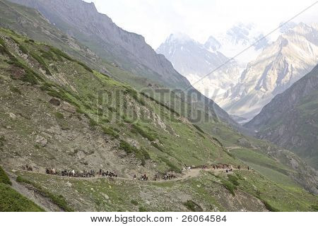 Pilgrims are coming back after the visiting a holy cave of Amarnath in the Himalayas
