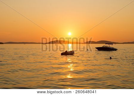 Sunset Over Adriatic Sea. Beautiful Seascape Evening Sunset Sea And Sky Horizon.
