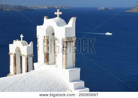 A greek orthodox church in Oia with sea background, Santorini.