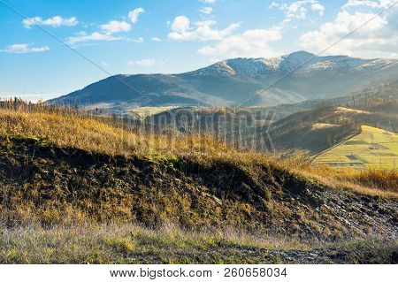 Grassy Hill In Autumn Mountains. Lovely Countryside. Distant Peak In Snow On A Bright Sunny Day