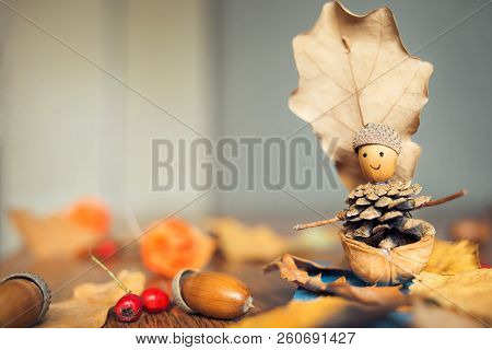 Autumn Craft With Kids. Children's Cute Boat With Man Made Of Natural Materials