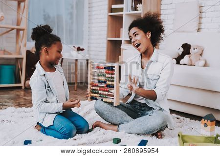 Happy Mother And Happy Girl Time Together. Child And Mother. Smart Girl With Mother Study. Child And