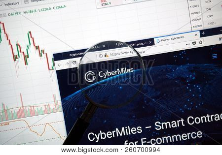 Montreal, Canada - September 8, 2018: Cybermiles Altcoin Site Under Magnifying Glass. Blockchain Is