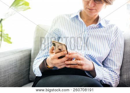 Paris, France - Sep 27, 2018: Fashionable Woman Testing The Newest Latest Iphone Xs And Xs Max Smart