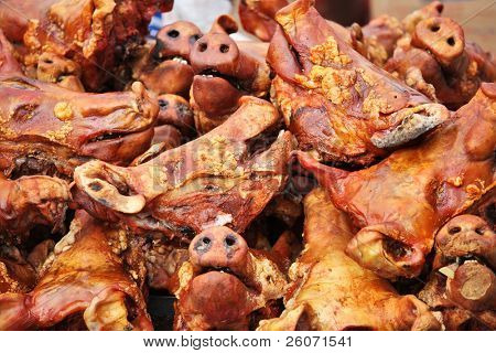 Grilled pig heads at ecuadorian farm market(can be used as illustration about swine flu)