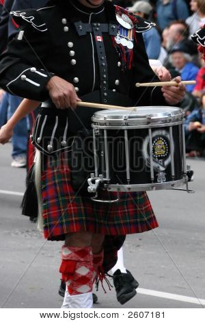 Kilted drummer in marching band Calgary Stampede Parade Calgary Alberta poster