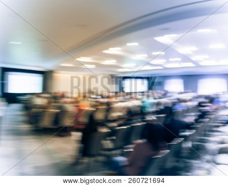 Panoramic Blurry Background Speaker On Conference Stage With Projector In Usa