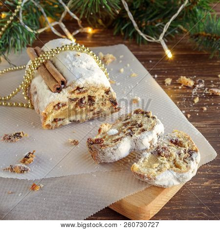 Traditional German Cake Stollen, Fruit Bread With Dried Fruit And Nuts, Covered With Powdered Icing