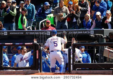 FLUSHING, NY - APRIL 7, 2012: New York Mets third baseman David Wright (5) is congratulated by teammates after hitting a solo homerun during the first inning against the Atlanta Braves at Citi Field