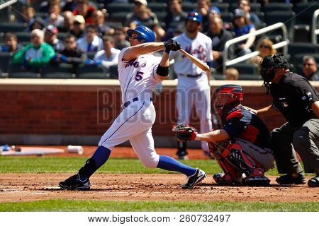 FLUSHING, NY - APRIL 7, 2012: New York Mets third baseman David Wright (5) hits a solo homerun during the first inning against the Atlanta Braves at Citi Field.