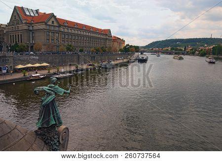 Prague, Czech Republic-august 21,2018: View Of Prague And Vltava River At Cloudy Summer Day. People