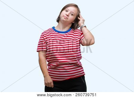Young adult woman with down syndrome over isolated background confuse and wonder about question. Uncertain with doubt, thinking with hand on head. Pensive concept.
