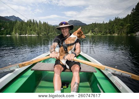 Traveller Man With Best Friend Dog On Boat