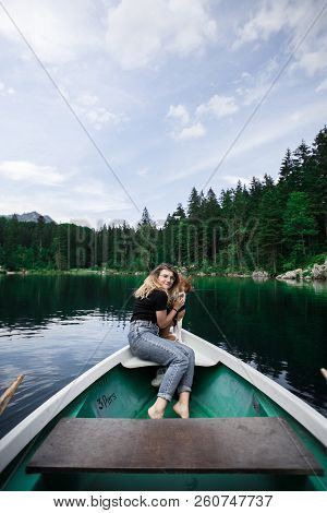 Hipster Travel Woman With Best Friend Pet On Boat
