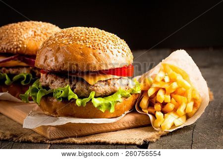 Close-up Photo Of Home Made Hamburger With Beer Made Of Beef, Onion, Tomato, Lettuce, Cheese And Spi
