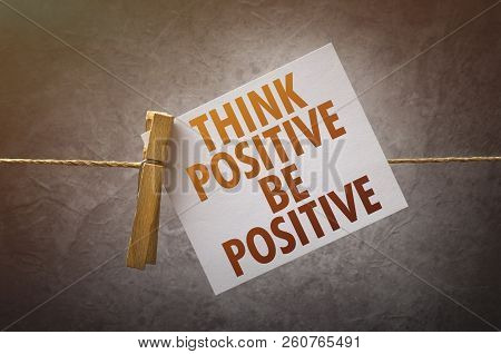 Think Positive Be Positive Paper Note Attach To Rope With Clothes Pins