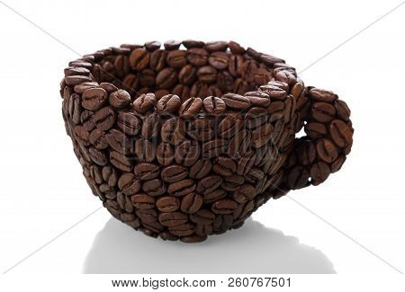 Cup Made Of Coffee Beans Isolated On White Background. Conceptual Photo