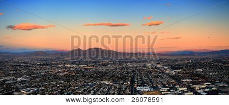 Las Vegas City Skyline panorama with sunset, mountain, luxury hotels and streets. poster