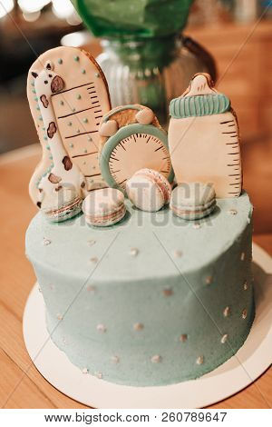 Pastel Color Decoration Of A First Year Birthday Cake On Wooden Table