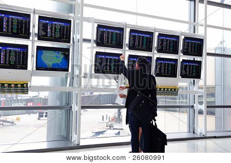 NEWARK, NJ -  OCT 5: Passenger check flight info on October 5, 2011 in Newark, New Jersey. Newark airport near New York City is 10th busiest in US and the 2nd-largest hub for Continental Airlines.