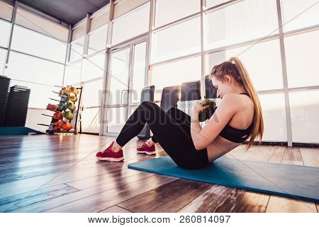 The Girl Is Training In Fitness Gym And Does Various Exercises. Concept Of A Healthy Lifestyle And E