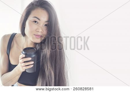 Young Asian Woman Holding A Cup Of Coffee, Smell Good And Enjoy The Coffee. Lady Lady Girl. Street S