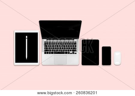 Flat Lay Photo Of Office Table With Laptop Computer, Digital Tablet, Mobile Phone And Accessories. O