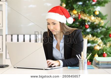 Office Employee Working On Line In Christmas Time With A Laptop