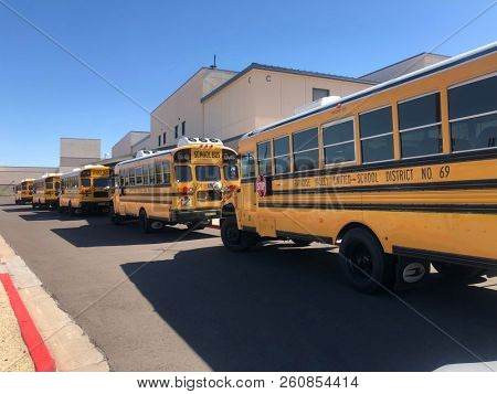 Phoenix,Az/USA -9.27.18:  School busses at Pinnacle High School which is located in north Phoenix, Arizona. PHS opened in 2000, and is a part of the Paradise Valley Unified School District.