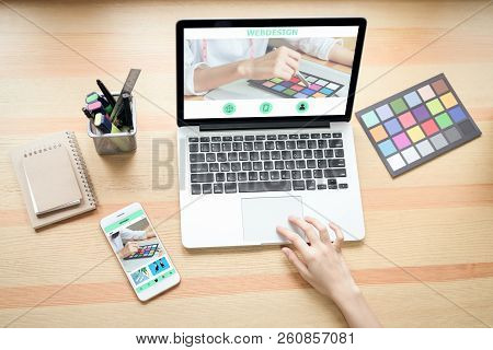 Businesswoman In Office In Casual Shirt. Use Computer For Graphic Designer And Choose A Color Sample