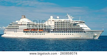 Cruise Ship. Large Luxury Cruise Liner On Sea Water And Cloudy Sky Background Docked At Port Of