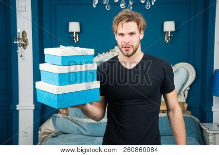 Boxing Day. Man Hold Present Boxes In Luxury Interior. Handsome Man Offer Luxury Goods. The Spirit O