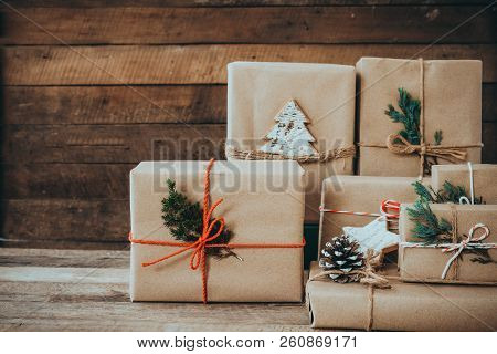 Christmas Handmade Present With Tag For Merry Christmas And New Year Holiday. Rustic Craft Gift Boxe