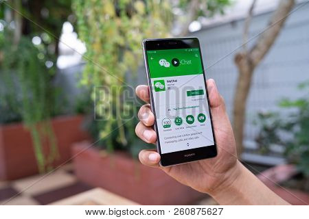 Chiang Mai, Thailand - August 05,2018: Man Holding Huawei With Wechat  On The Screen.wechat Is A Chi