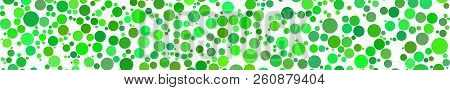 Abstract Horizontal Banner Of Circles Of Different Sizes In Shades Of Green Colors On White Backgrou