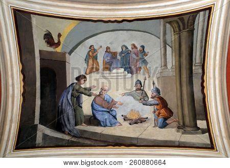 STITAR, CROATIA - JUNE 24: Peter denies Jesus before the rooster crows three times, fresco in the church of Saint Matthew in Stitar, Croatia on June 24, 2017.