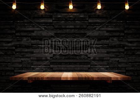 Empty Brown Plank Wood Shelf At Black Layer Marble Tile Wall Background,mock Up For Display Or Monta