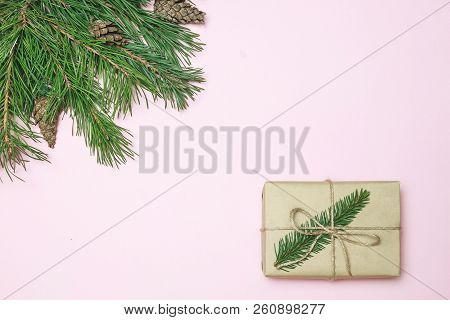 Christmas Composition. Christmas Frame Made Of Conifer, Fir Branches Decorations On Pink Background.