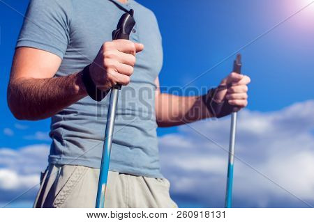 Nordic Walking, Exercise, Adventure, Hiking Concept -man Hiking In The Nature
