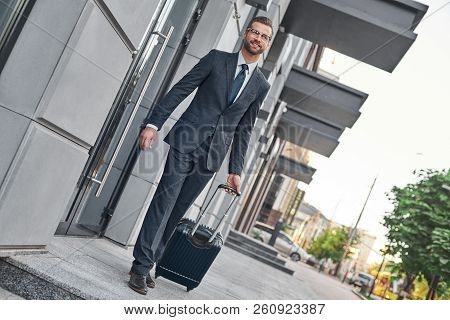 Full Length Of Young Man In Full Suit Gesturing And Shouting Whi