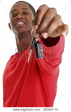 Casual Young Man Holding Out Car Key. Focus on hand and key.  Face out of focus.  Shot in studio over white.
