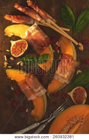 Cantaloupe Melon Sliced With Prosciutto. Italian Appetizer