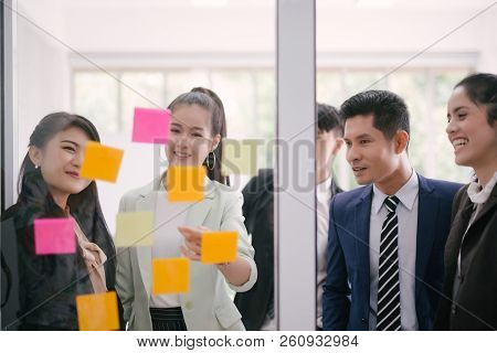Business People Meeting At Office And Explaining To Colleagues Over Sticky Notes In Office Brainstor