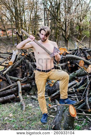 Masculine leisure. Lumberjack woodman sexy naked muscular torso gathering wood. Man brutal attractive guy collecting wood forest. Axe woodsman equipment. Man beaded brutal sexy lumberjack carry axe poster